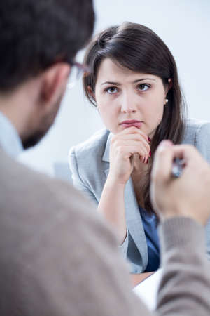 trouble: Woman with problem listening the psychotherapists advice