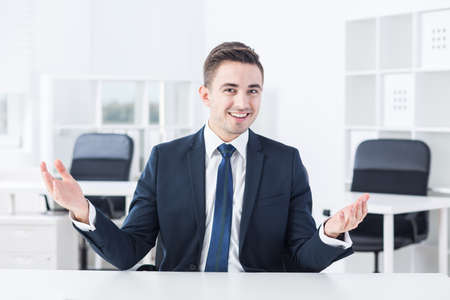 talkative: Young businessman is very talkative during his job interview Stock Photo