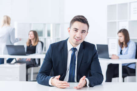 contacting: Young businessman is contacting with his client via skype Stock Photo