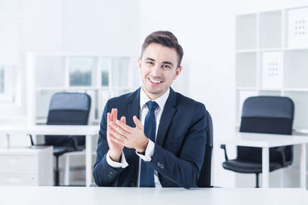 congratulating: Young manager is congratulating his worker via online