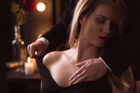 women sex: Man gently undressing elegant beautiful aroused woman