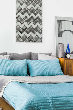 bedcover: Double bed with cute blue bedcover in cozy bedroom Stock Photo