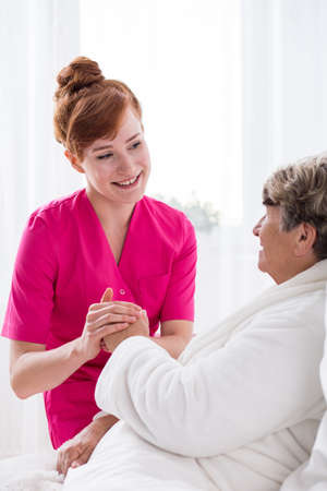 geriatric care: Picture of nurse supporting elderly woman before operation Stock Photo
