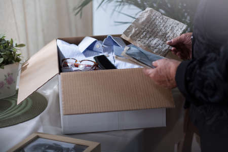 put away: Woman is reading old letters before putting it away