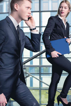 Corporations: Busy businessman and businesswoman working in corporation