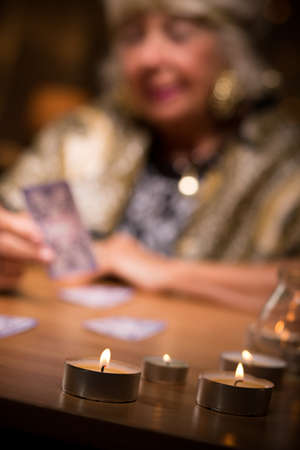 clairvoyant: Close-up of fortune teller with candles on her table