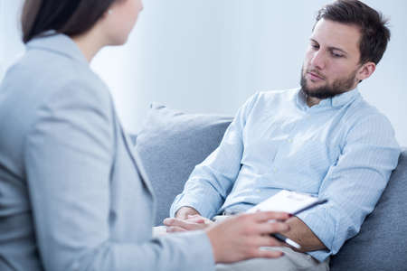 treating: Middle aged handsome man with depression treating at psychiatrists Stock Photo