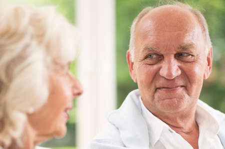 the devotion: Elder man looking at his wife with love and devotion Stock Photo