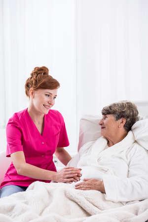 geriatric: Image of senior lady with nurse on geriatric ward Stock Photo