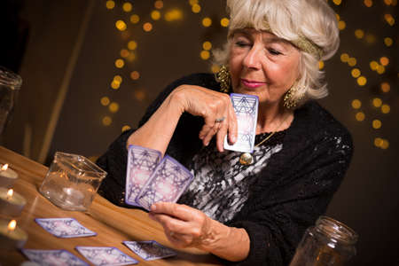 telepathy: Fortune-teller forecasting the future from magic cards Stock Photo