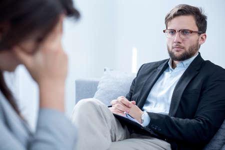 psychiatrist: Smart handsome young psychiatrist and his patient