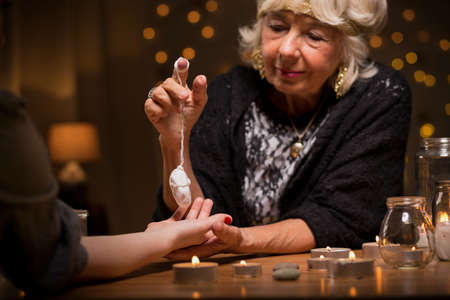 fortune telling: Woman visiting a fortune teller to know her future Stock Photo