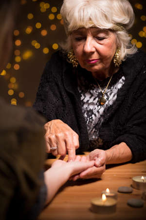 astrologist: Visit to a fortune-teller reading a hand