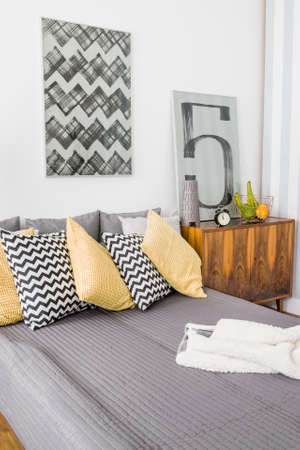 room decor: Cozy vintage style bedroom with comfortable double bed Stock Photo