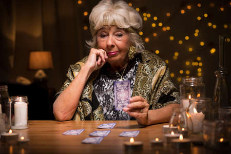 astrologist: Fortune-teller with tarot cards predicting the future