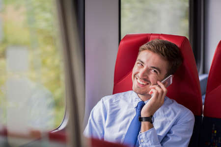 delegation: Happy handsome man going to work by train Stock Photo