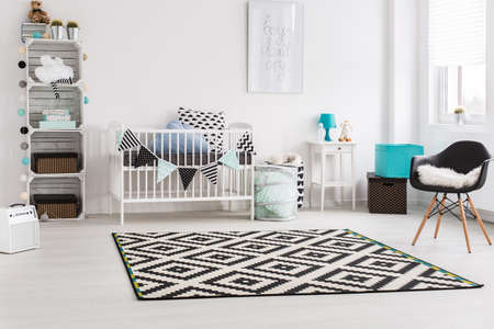 room decoration: Shot of a stylish modern baby room