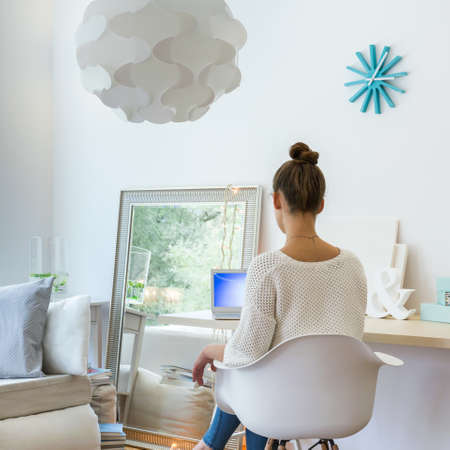 home  lighting: Photo of woman sitting on chair in cosy furnished room