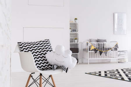 white pillow: Shot of a black and white baby room