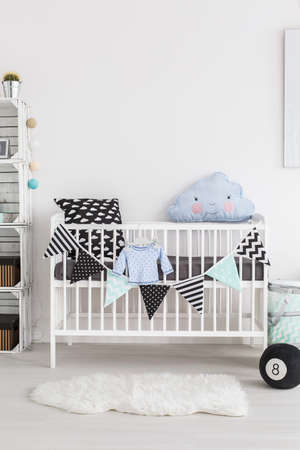 nursery room: Shot of a crib in a scandinavian style baby room