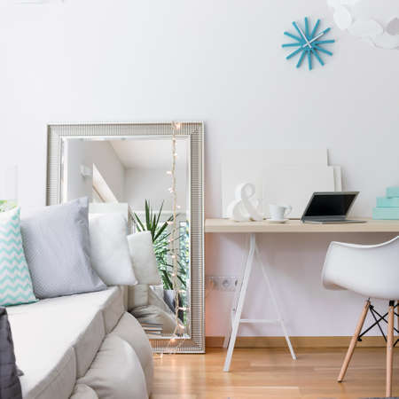 desk area: Image of simple study area with wooden desk and chair Stock Photo