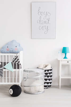 indoor inside: Shot of a black and white baby room with blue accessories