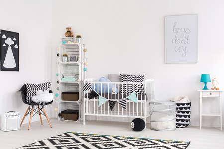 modern chair: Shot of a stylish modern baby room