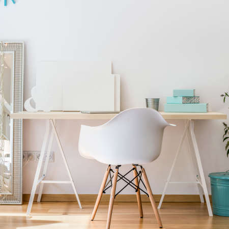 Study Desk: Photo of simple desk and white fashionable chair Stock Photo