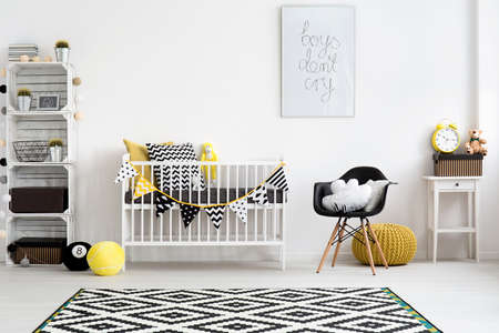 YELLOW: Picture of a modern baby room designed in scandi style
