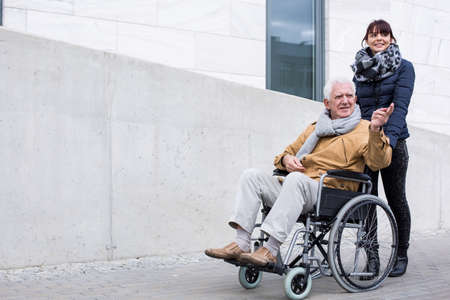 paralysis: Image of love and support between disabled father and daughter Stock Photo
