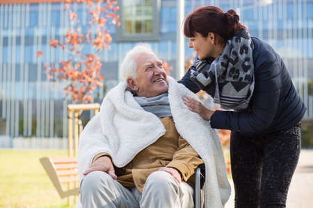 grandad: Photo of elderly man and his caring daughter