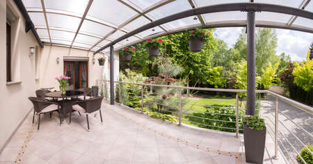 porches: Panorama of stylish terrace and beauty garden Stock Photo