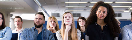 listeners: Young curious students on university interested in lecture with professor listening carefully Stock Photo