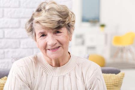 woman sweater: Portrait of a smiling senior woman