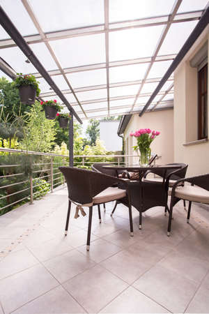 tasteful: Tasteful and wicker furnitures on the terrace Stock Photo
