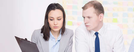 workmates: Picture of two workmates focused in the office Stock Photo