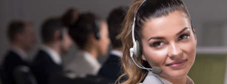 hot line: Young beautiful girl with headset working in call center office