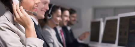 selling service: Close-up of young woman working in call center company as a telemarketer Stock Photo