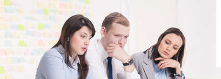 workmates: Three workmates thinking about a new project Stock Photo