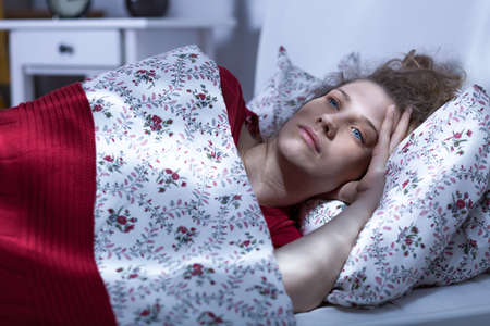 woman in bed: Image of bethinking sad woman lying in bed
