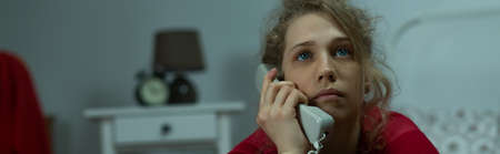 isolation: Panorama of depressed lonely woman talking on phone