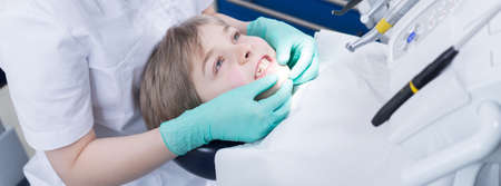 Boy during visit at dentist office, panorama