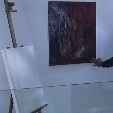 loot: Photo of art thief with flashlight examining loot