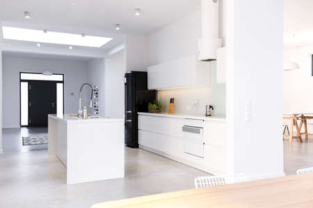 White new kitchen with island in the middle