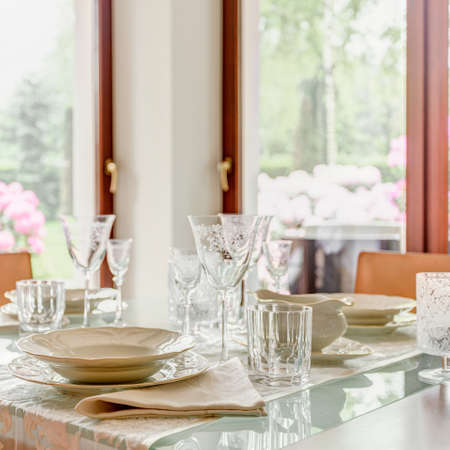 stemware: Crystal stemware and porcelain tableware on the table