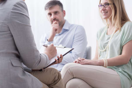 psychiatrist: Young woman and her husband taking advice at psychiatrist Stock Photo