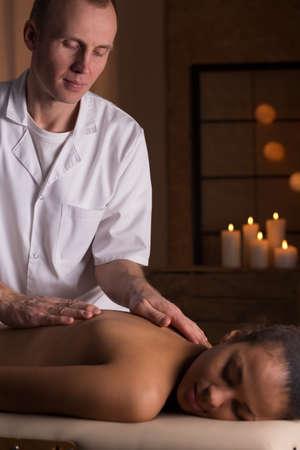 beauty resort: Young relaxed beautiful woman having deep tissue massage at beauty resort Stock Photo