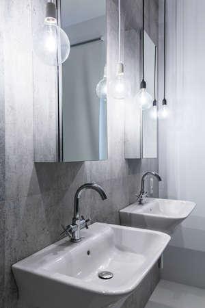 basins: Gray luxury bathroom with two small basins Stock Photo
