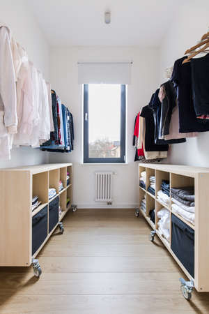 tidy: Tidy spacious closet with wooden floor in big house Stock Photo