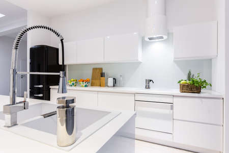 kitchen island: Modern designed elegant white kitchen with island Stock Photo